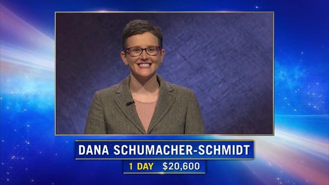 """Tecumseh's Dana Schumacher-Schmidt smiles as she is introduced as the returning champion during Wednesday's episode of the quiz show """"Jeopardy!"""" Schumacher-Schmidt was unable to repeat as """"Jeopardy!"""" champion, earning second-place during Wednesday's episode."""