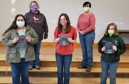 From Left to right front- Emma Diliberti, Emma Modrovsky, and Michaela Reed Left to right back- Livestock Judging Team Coaches- Linda Marshall and Diane Rickard