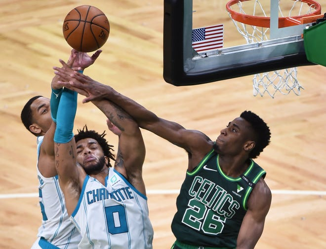 Apr 28, 2021; Boston, Massachusetts, USA;  Charlotte Hornets forward Miles Bridges (0) and Boston Celtics forward Aaron Nesmith (26) battle for a rebound during the second half at TD Garden.