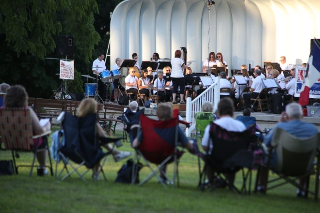 In this file photo, the Burlington Municipal Band performs Sunday July 8, 2018, in Crapo Park. After missing an entire year due to the pandemic, Burlington Municipal Band is set to resume its summer concert series.