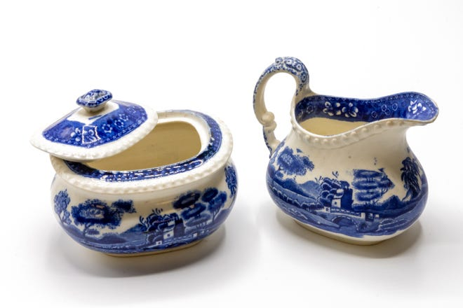"""A pair of Copeland sugar and creamer ware, an Out of the Attic item, is shown at the Des Moines County Heritage Center, 504 N. Fourth St., in Burlington. The objects are what is known colloquially as """"blue willow ware"""" and, in this case at least, are English in origin. They were made by Copeland, Spode's Tower, England. And, they are made of bone china."""