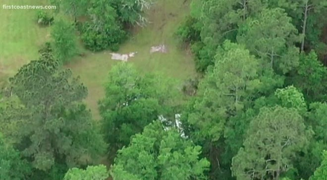 An image from a drone shows part of the airplane wreckage in the woods off Violet Way in Middleburg following Wednesday's fatal crash.