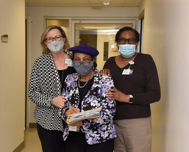 With 60 years tenure, Cecil Wright (center), 79, is UF Health Jacksonville's longest-serving employee. Here she is flanked by her Health Information Management bosses: director Annette Wrabel (left) and operations manager Sandra Walker.