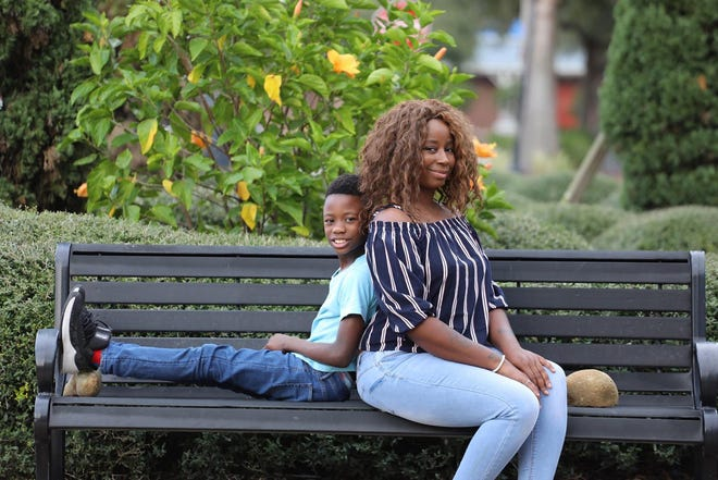 Heart disease survivor Sharifah Abdullah and her 10-year-old son, Elijah Hobbs. She had to push her doctors for further testing after they attributed her nighttime shortness of breath to anxiety.
