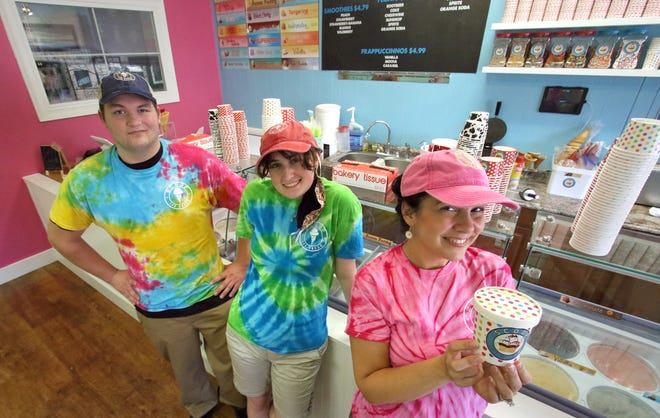Cole Ballard, Elyse Allan and owner Amy Brevard pose together inside Scoop Kings Mountain, a new ice cream shop, on Railroad Avenue in Kings Mountain Thursday afternoon, April 29, 2021.