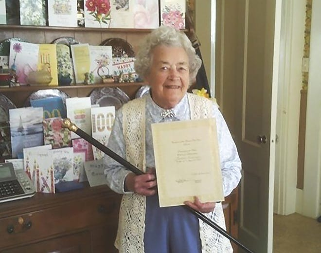 Rachael Bush Whitney, 100, received the Boston Post Cane in recognition of being the oldest resident of Ashburnham.