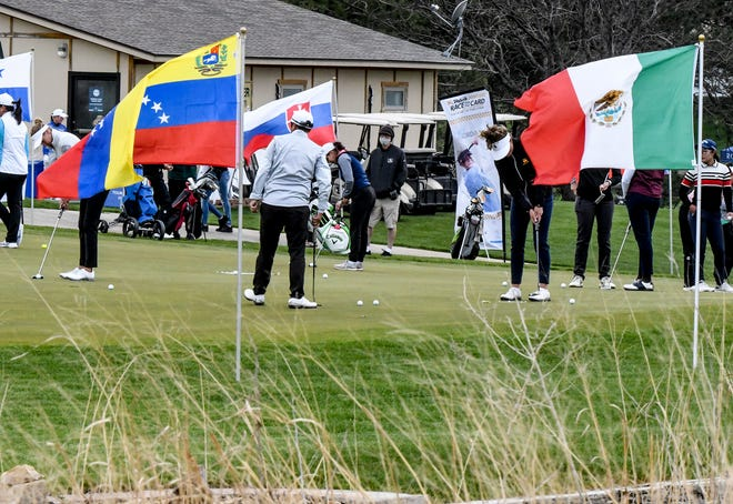 Flags representing all the nations of the players surround the practice putting green as professional players on the Symetra Tour get some practice time in at the Buffalo Dunes golf course Wednesday.  The Garden City Charity Classic got underway Friday morning and runs through Sunday.