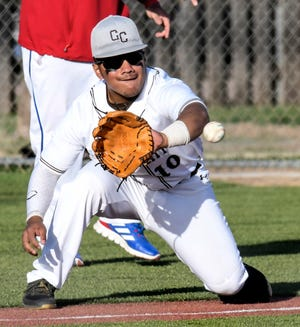 Garden City High School third baseman Jesse Baltazar comes off the bag to take a throw April 6 against Dodge City at Clint Lightner field.