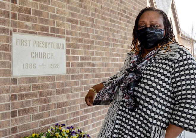 Doris Evans, Interim Pastor at the Garden City First United Presbyterian Church, is shown outside the church on Thursday. The church is celebrating its 135th anniversary in Garden City this year.
