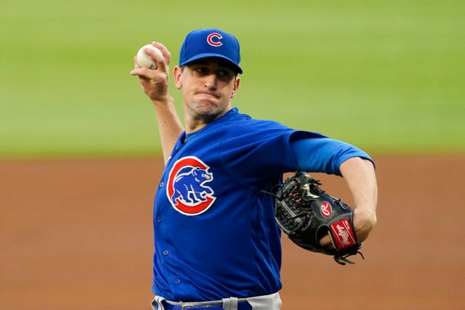 Chicago Cubs starting pitcher Kyle Hendricks (28) works against the Atlanta Braves in the first inning of  Wednesday's game in Atlanta.