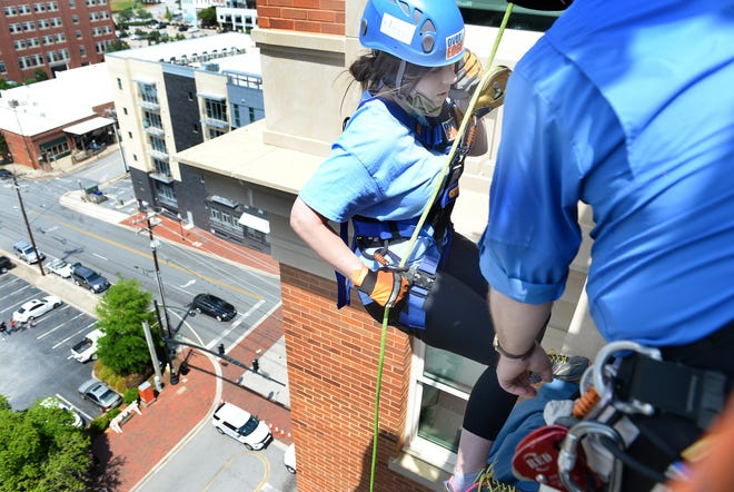 The Over the Edge event took place at the AC Hotel in downtown Spartanburg on April 29, 2021. Ashley Dill of the  Spartanburg Herald-Journal staff goes over the side of the AC Hotel in Spartanburg.