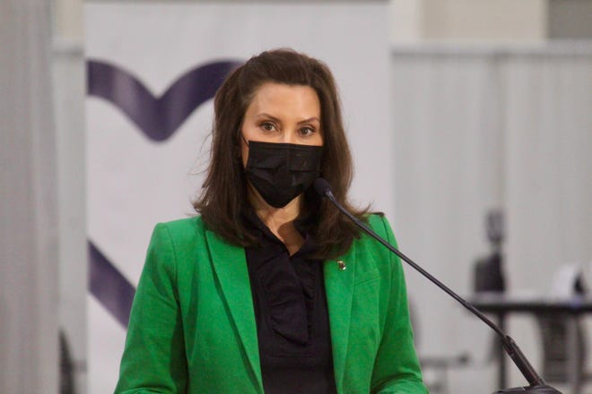 Michigan Gov. Gretchen Whitmer speaks before receiving her second dose of the COVID-19 vaccine on Thursday, April 29, 2021, at the DeVos Convention Center in downtown Grand Rapids, Mich.