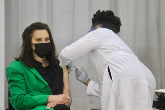 Dr. Joneigh Khaldun, Michigan chief medical executive, administers the COVID-19 vaccine to Gov. Gretchen Whitmer on Thursday, April 29, 2021 at the DeVos Convention Center in downtown Grand Rapids, Mich.