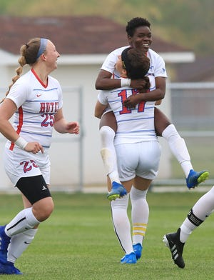 Hutchinson's Esther Karhayu (4) celebrates with teammate Marah Franke (17) after scoring a goal against Barton County Wednesday evening. HCC defeated Barton 3-0.