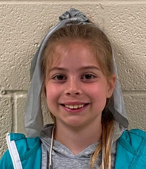 """Alexandria Mills from Cottageville Elementary won the third and fourth grade category with """"My Dog Charlie."""""""