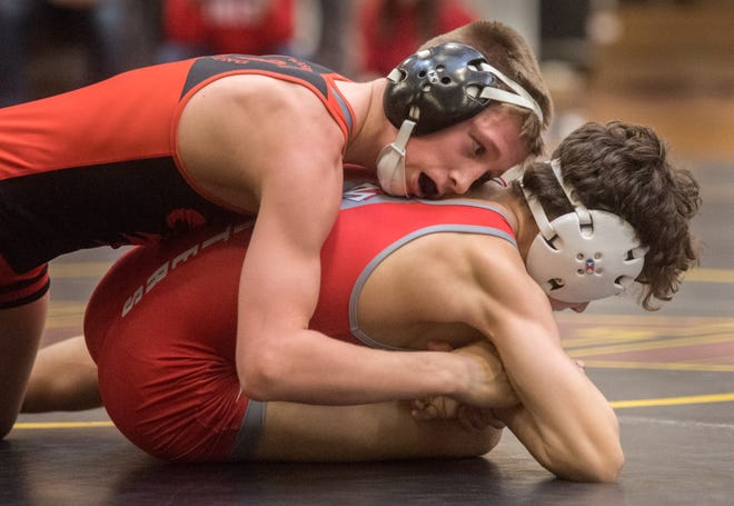 Washington's Kannon Webster, top, and Morton's Connor Kidd grapple in the 106-pound title match of the Mid-Illini Conference wrestling meet Saturday, Jan. 25, 2020 at East Peoria High School.