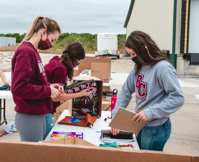Bethel Students packed school kits to ship overseas, at Mennonite Central Committee Central States headquarters in North Newton during a service day last September. The school is one of the just 28 percent of colleges to see an enrollment increase this year.