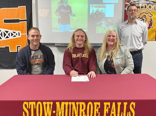 Stow-Munroe Falls senior Nicholas Kuhlke signed a national letter of intent to continue his academic and soccer careers at the University of Findlay. Pictured are, from left, father Drew Kuhlke, Nicholas Kuhlke, mother Diane Kuhlke and Stow soccer coach coach Kyle Kosmala.