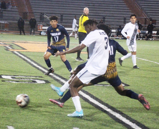 Otero Junior College's Oussenyou Cisse (3) battles Trinidad State's Jonathan Wilson (11) in Wednesday's game at Tiger Stadium. The Rattlers lost 1-0.