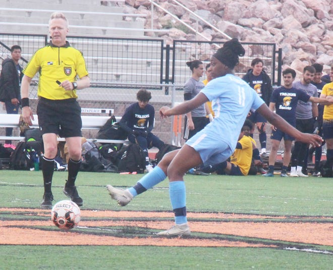 Otero Junior College's Jacqueline Kambere (11) kicks the ball away in Wednesday's game at Tiger Stadium. The Rattlers won the game 2-1.