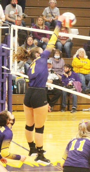 Fowler High School's Tannice Wetzel goes up for a kill against Swink on March 25, 2021, at Fowler High School. The Grizzlies will host the Class 2A Region 5 Tournament Tournament on Saturday.