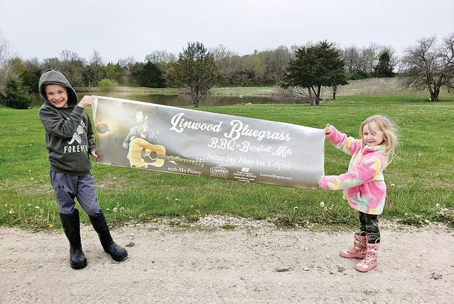 Sawyer and Violet Aipperspach are shown publicizing the Linwood Bluegrass Festival which is being held Saturday.