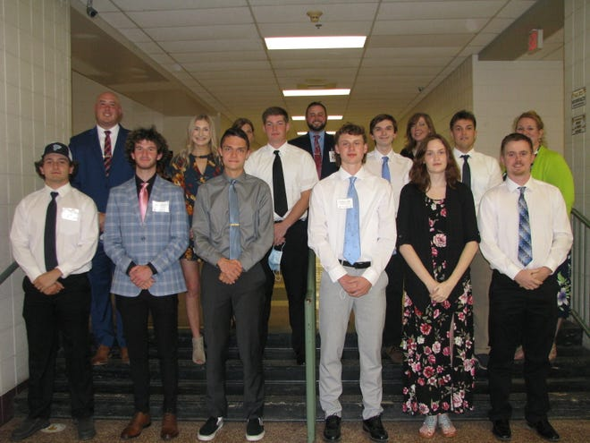 Frankfort High School seniors honored during the 33rd annual Achievement Awards Banquet included (front, l-r) John Bittinger, Corey Brieloff, Christian Cimaglia, Jachob Clark, Alyssa Guthrie, Jacob Logsdon, (second row) Katie Miltenberger, Benjamin Nestor, Kyle Slayman and Brady Whitacre. Also pictured are FHS principal Orie Pancione, board of education vice president Mary Jane Baniak, superintendent Troy Ravenscroft, board president Lara Courrier, and FHS assistant principal Heather Morrison.