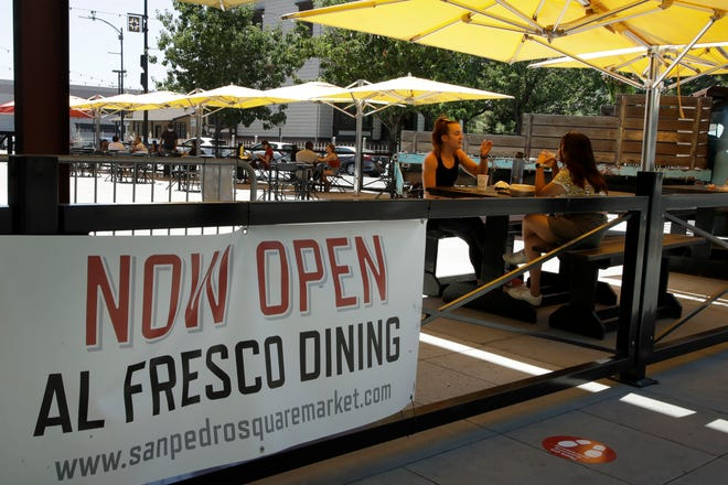 People eat outdoors at San Pedro Square in San Jose, California, on July 6, 2020. Tens of thousands of small businesses closed due to the coronavirus pandemic, many of them permanently. Those still standing desperately need community support to stay open or reopen. Among business owners who closed during the pandemic and later reopened, 31% cited customer support as the reason they were able to do so. [AP File Photo/Ben Margot]