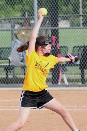 A young softball player prepares to deliver a pitch during a Moberly Parks and Recreation Department age 10U girls softball league played in the 2020 summer season at Howard Hils Athletic Complex.
