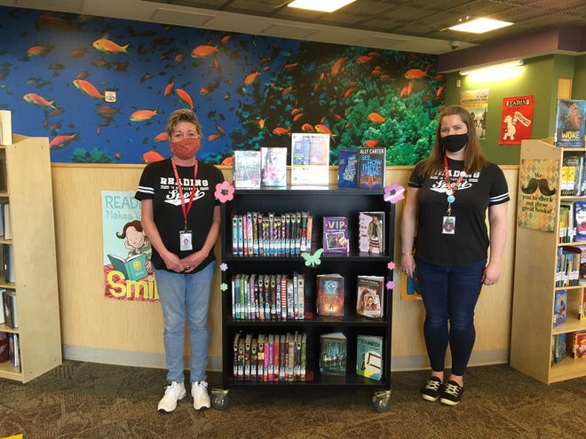 Canandaigua Middle School library aide Cay-Lee Sick and Librarian Melanie Dyroff often greet students with a smile, even if they're behind the COVID-19 masks.