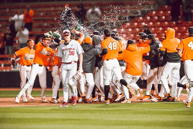 OSU celebrates the walk-off win over OU on March 30. Caeden Trenkle had the game-winning hit.