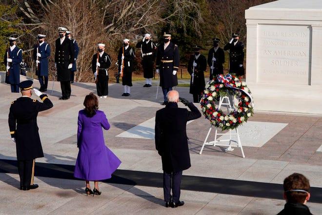 President Joe Biden, right, Vice President Kamala Harris, center, and Maj. Gen. Omar J. Jones, left, salute at the Tomb of the Unknown Soldier on Jan. 29 in Arlington Cemetery in Arlington, Virginia, after being sworn in.