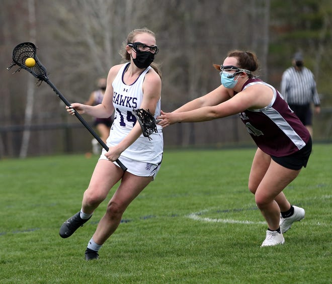 Meagan Wentworth, left, gets by a Noble defender during Wednesday's girls lacrosse game. Wentworth had two goals and four assists in Marshwood's 13-2 win.
