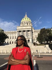 LaQuisha Anthony stands in front of the Capitol building in Harrisburg, PA.