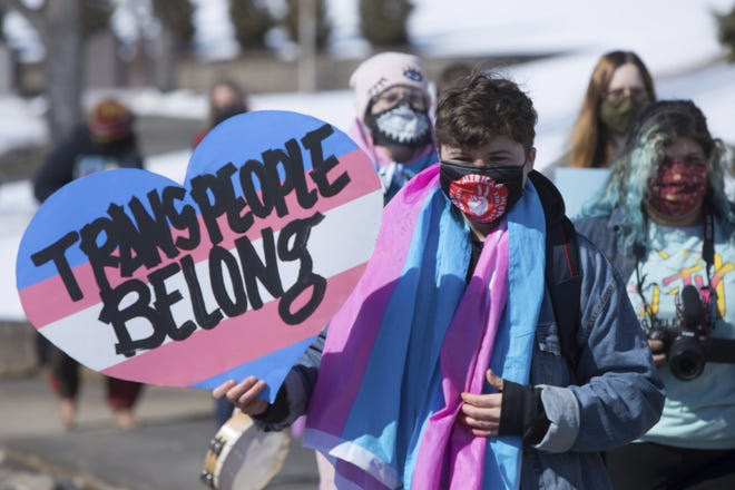 IMAGE DISTRIBUTED FOR HUMAN RIGHTS CAMPAIGN - Protestors march against a bill restricting transgender girls from sports teams in Pierre, South Dakota on Thursday, March 11. (Toby Brusseau/AP Images for Human Rights Campaign)