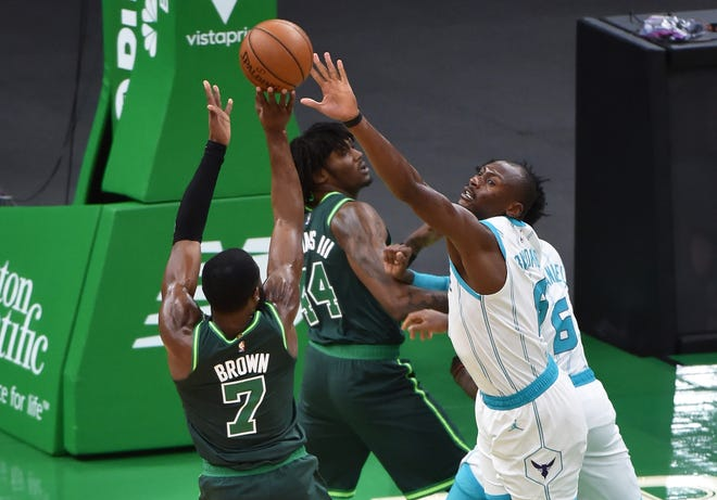 Celtics guard Jaylen Brown, left, shoots the ball over Charlotte Hornets center Bismack Biyombo during the first half Wednesday night at TD Garden. Brown led Boston with 38 points.