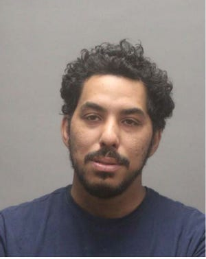Derek Franklin, 35, of Woonsocket, is accused of stealing an SUV occupied by a toddler