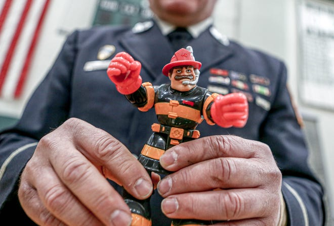 Retired FDNY Lt. Joe Torrillo holds Billy Blazes, the Fisher-Price toy he was to help launch on Sept. 11, 2001. Fate had other plans for him that day.