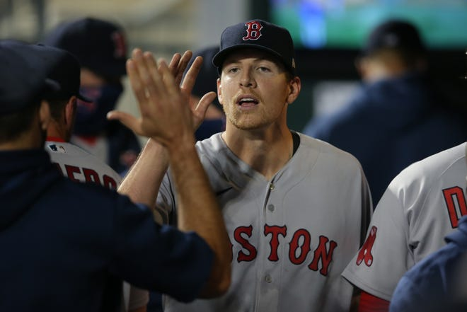 Red Sox starting pitcher Nick Pivetta gets high-fives in the dugout after his outing Wednesday night against the New York Mets. Boston won, 1-0.
