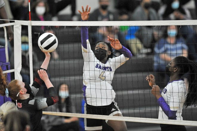St. Raphael's Liz Bruno comes up with a one-handed block during the first set in Thursday's Division III semifinal against Narragansett. Bruno and the Saints advanced to Saturday's final with a 3-0 win over the Mariners.