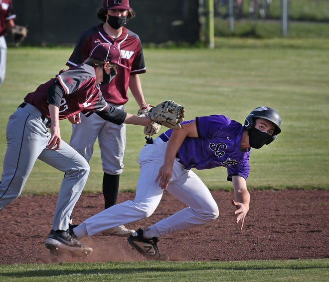Willamette's Noah Cox, left, tags South Eugene's Leo Reeves after he was caught off base between first and second during the fourth inning of their baseball game Wednesday.