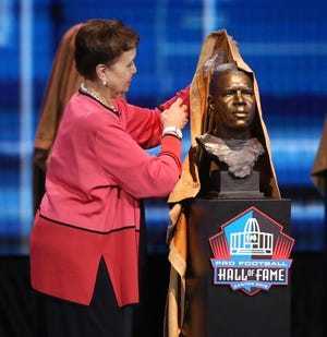 Sandra Wikins unveils bust of her uncle Duke Slater as one of the newest members of the Pro Football Hall of Fame at Umstattd Hall in Canton on Wednesday, April 28, 2021. The event posthumously recognized his contributions to the game.