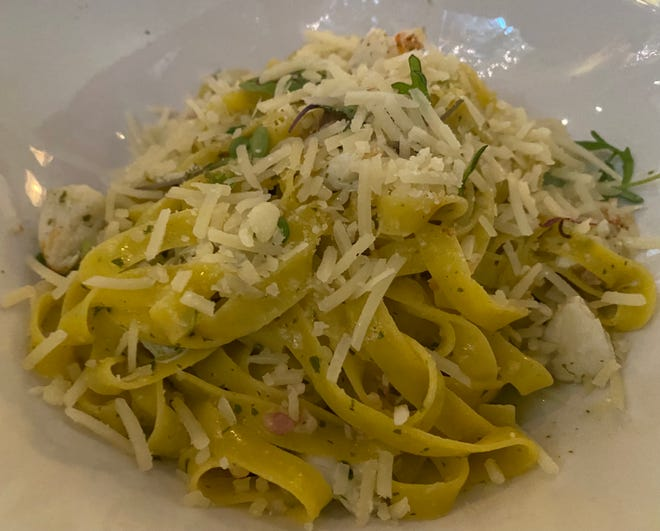 Crab fettuccine is a winning dish at Lucca Downtown, featuring lump crab, bacon and basil aglio.