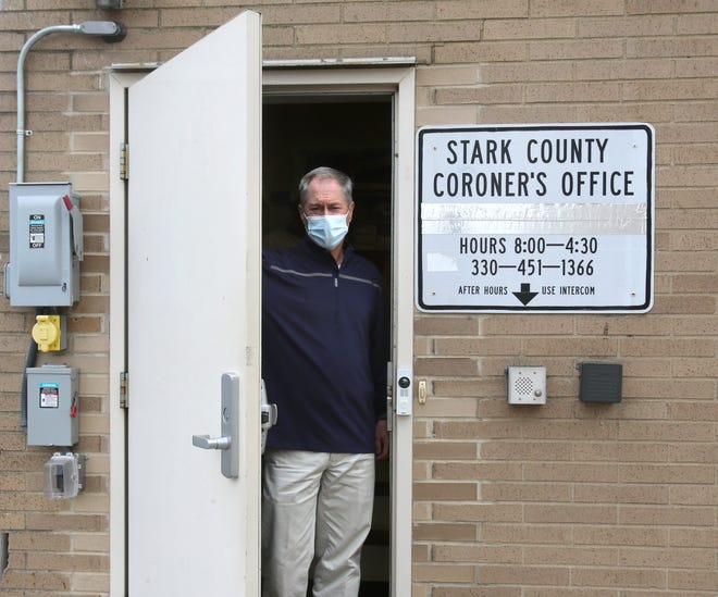 Dr. Ron Rusnak, Stark County coroner, is shown in the doorway outside his office. Stark County is having difficulty hiring a pathologist, a problem experienced by many communities.