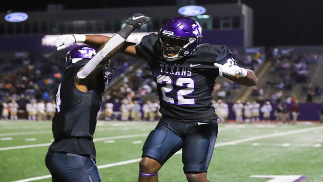 Tarleton State running back Ryheem Skinner (22) celebrates a play during a game during TSU's spring season earlier this year. Reserved season tickets for the upcoming fall season go on sale Monday.