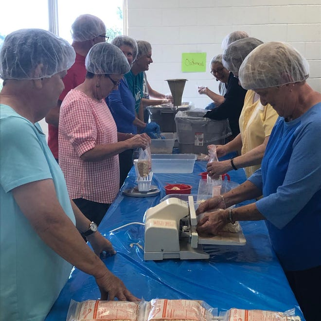 Volunteers pitch in during an event in Cleveland County.