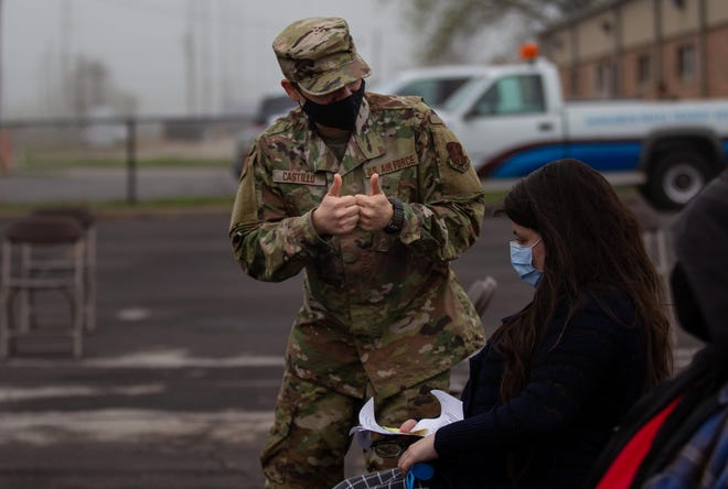 Senior Airman Stephen Castillo gives thumbs-up signs to Pamela Herman after the end of Herman's observation period post-vaccination Thursday at a walkup clinic at the SMTD Downtown Transfer Center in Springfield. The event was the result of a partnership between SMTD and the Sangamon County Department of Public Health to deliver free COVID-19 vaccinations to the public.