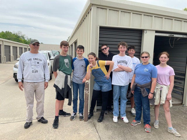 Student volunteers from Mrs. Faith Buss's Civics and Government class at Christian Family Academy stand with Bill Hagen of the Shawnee Library Friends after having moved over 60 boxes of books to a storage unit. The books will be brought out for the next big Friends' book sale.