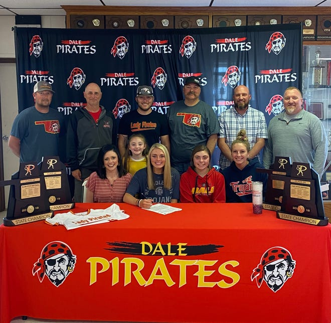 Dale High School senior catcher Danyn Lang has signed a letter of intent to play softball at Seminole State College next season. Seated are Danyn's mother Sommer, Danyn, sister Daily and sister-in-law Hanna Lang. Standing are coach Bryce Clemons, coach Andy Powell, brother Dylan Lang, sister Daxly, father Josh Lang, coach Eric Smith and coach Scott Wilson.