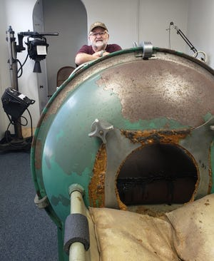 Kewanee Historical Society Board President Mike DeWalt recently offered a tour of some of the museum's more unusual items that will be on display at its grand opening 1 p.m. Saturday. Here, DeWalt stands behind an iron lung, an item purchased by Kewanee residents during an epidemic of Polio.